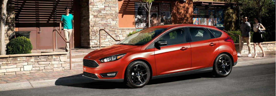 2018 ford focus sel in red parked on road