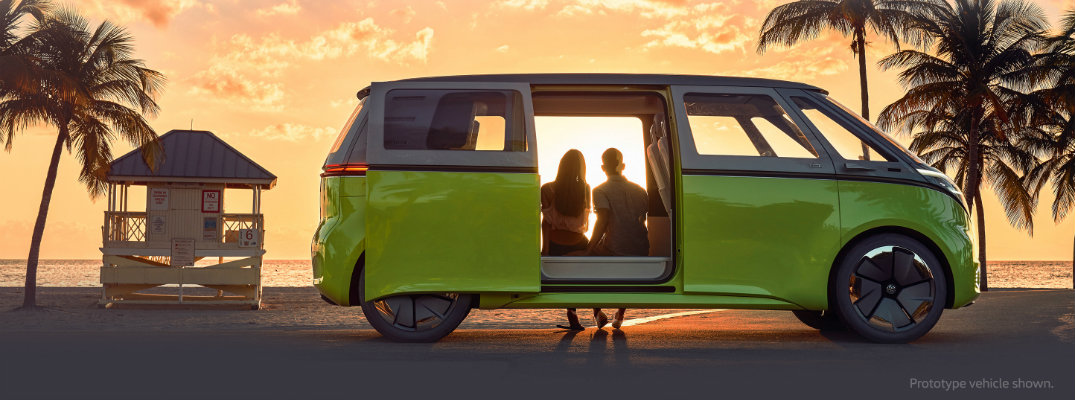 ID BUZZ Volkswagen van sitting on the beach buy the sunset
