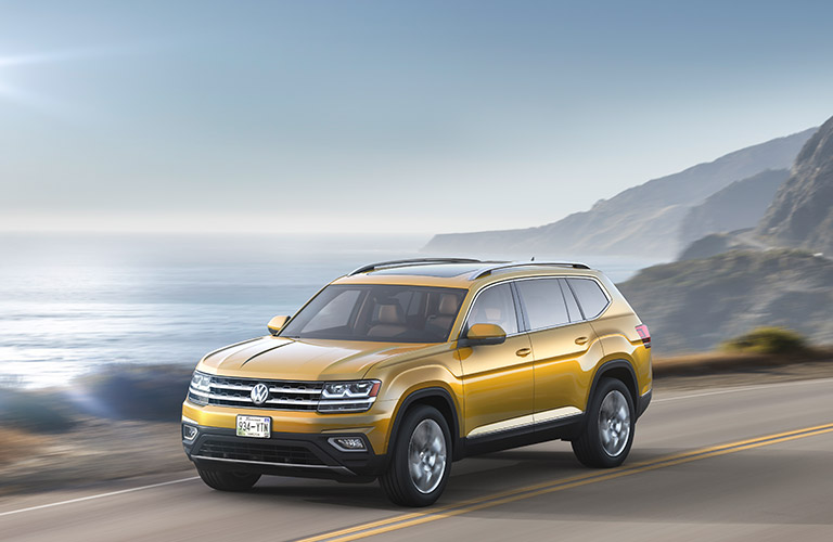 Yellow Volkswagen Atlas parked by the ocean