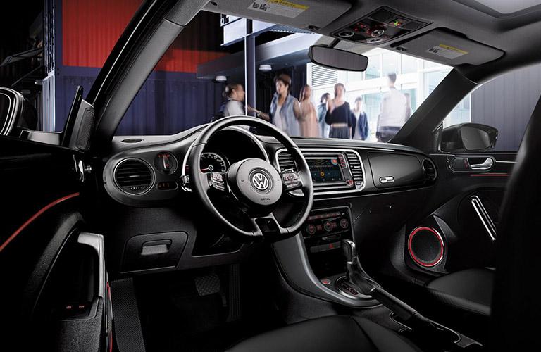Steering wheel and touchscreen inside the 2018 Volkswagen Beetle