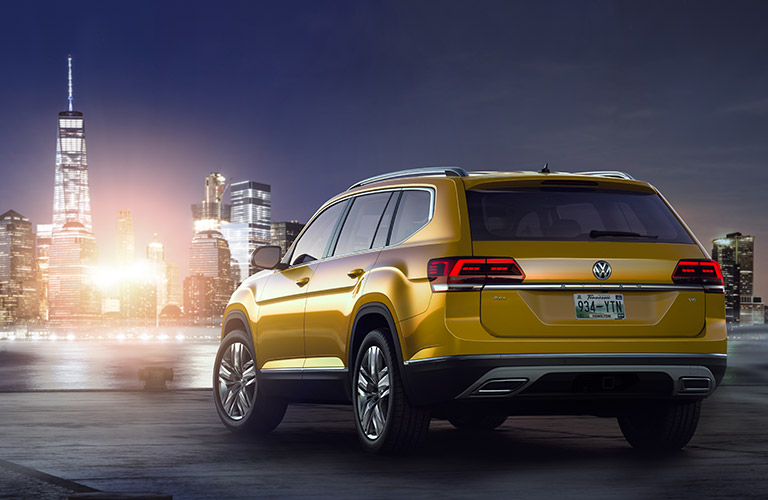 Gold 2018 Volkswagen Atlas parked in front of the city