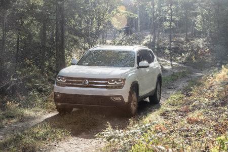 2018 Volkswagen Atlas drives through a forest