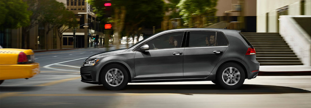 2018 Volkswagen Golf driving in the city