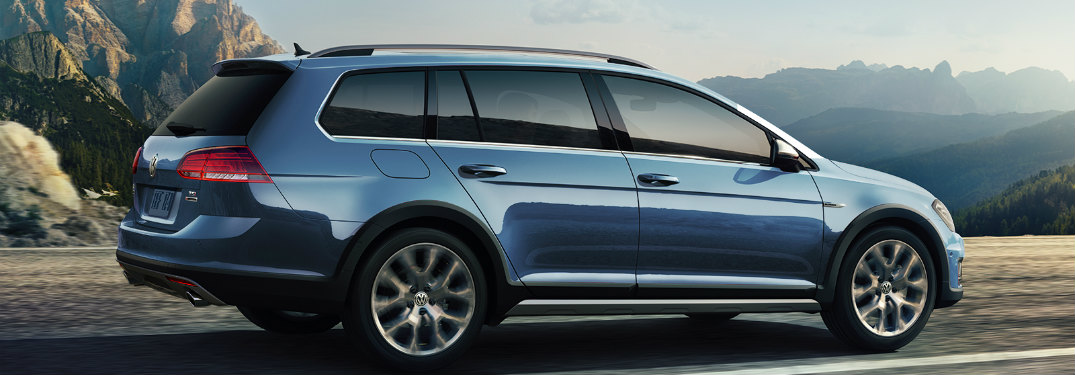 2018 Volkswagen Golf Alltrack driving down a country road