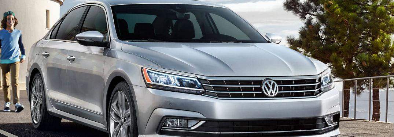 Man approaching a parked 2018 Volkswagen Passat SEL Premium