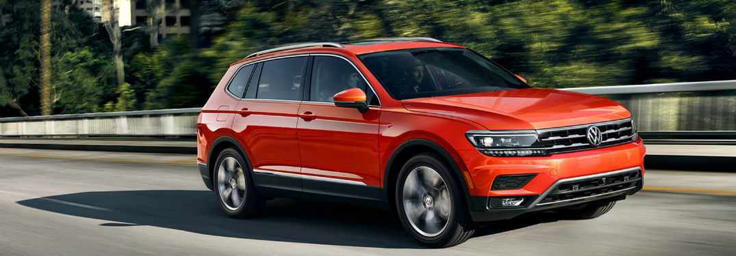 2018 Volkswagen Tiguan driving down a road