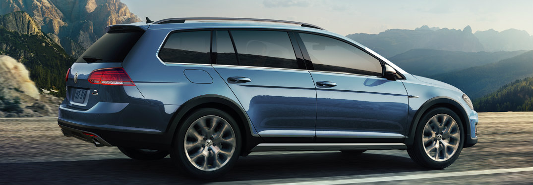 2018 Volkswagen Golf Alltrack driving down a mountain road