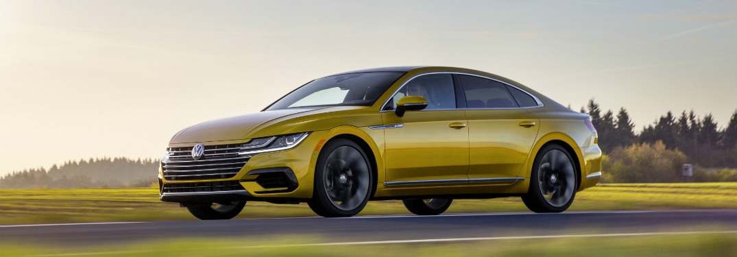 2019 Volkswagen Arteon driving down a country road at sunset