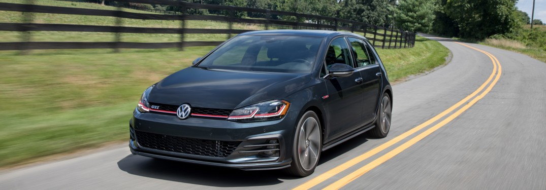 2018 Volkswagen Golf GTI driving down a curving road