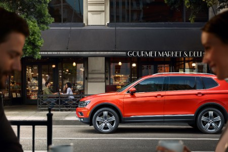 2019 Volkswagen Tiguan parked in front of a business on a street