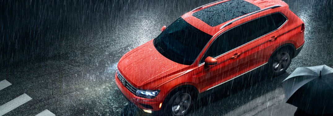2019 Volkswagen Tiguan parked on a rainy city street