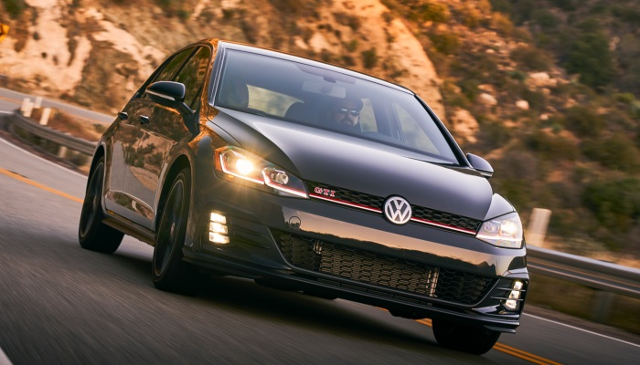 2019 Volkswagen Golf GTI driving down a mountain road