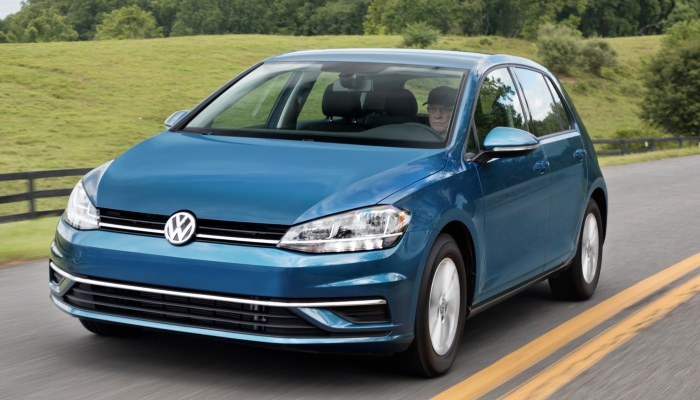 2018 Volkswagen Golf driving down a rural road