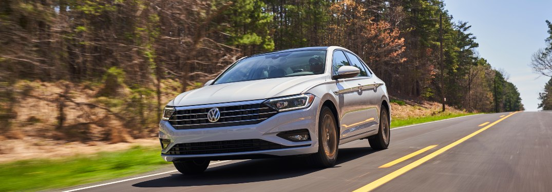 2019 Volkswagen Jetta driving down a rural road