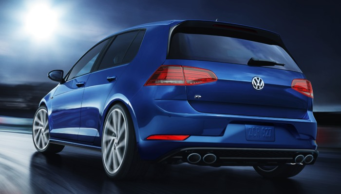 2019 Volkswagen Golf R driving down a curving road at night