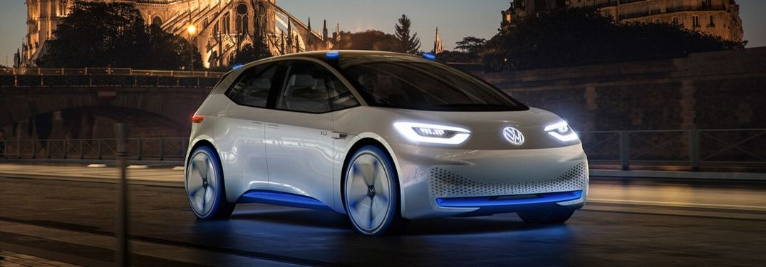 Volkswagen ID. concept car from exterior front passenger side in front of castle
