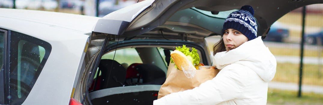 woman putting food in her vehicle