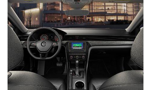 2020 VW Passat interior shot from between front seats showing building through window