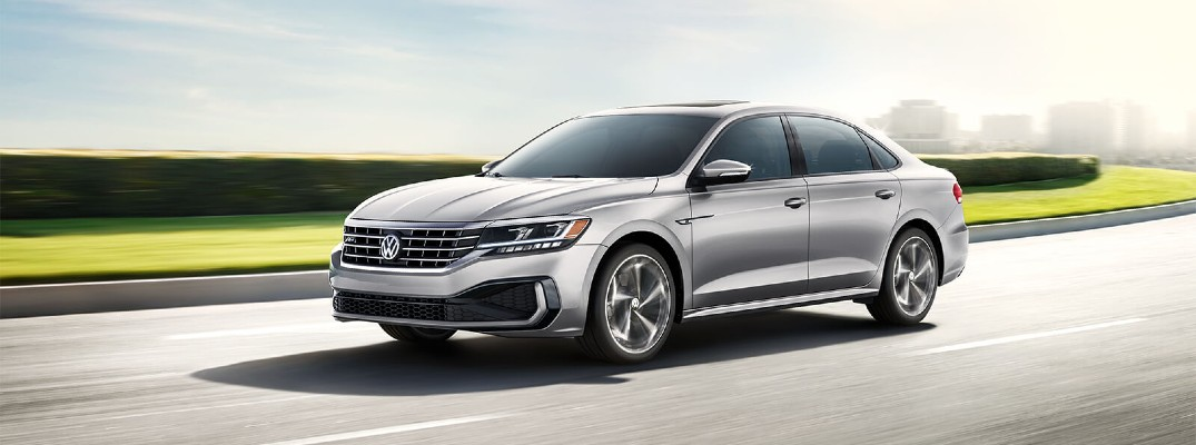 2020 VW Passat silver driving to the right nondescript road