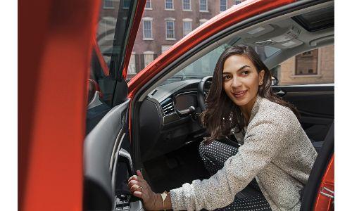 2020 Jetta SEL Premium orange woman going into car closing door