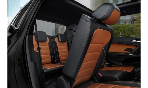 2020 VW Tiguan orange and back seats showing one seat folded up