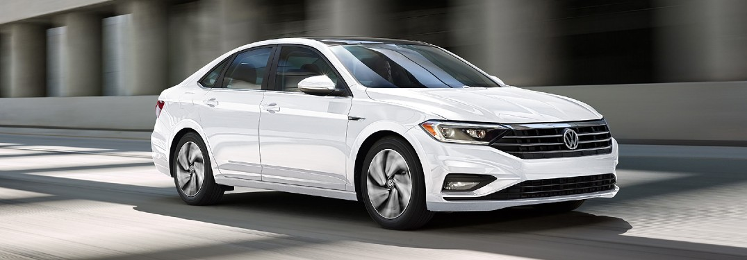 2020 Volkswagen Jetta SEL Premium white driving surrounded by concrete second angle
