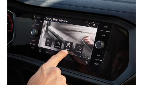 2020 Volkswagen Jetta interior showing hand touching info screen