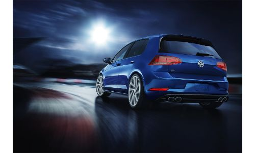 2020 Volkswagen Golf R blue driving away from shot at night