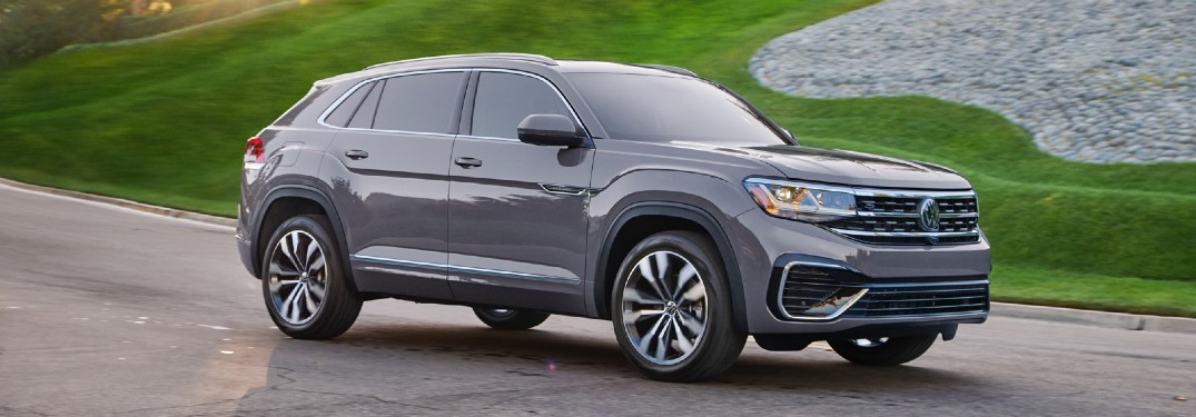 2021 Volkswagen Atlas Cross Sport driving past green grass 2020 model shown