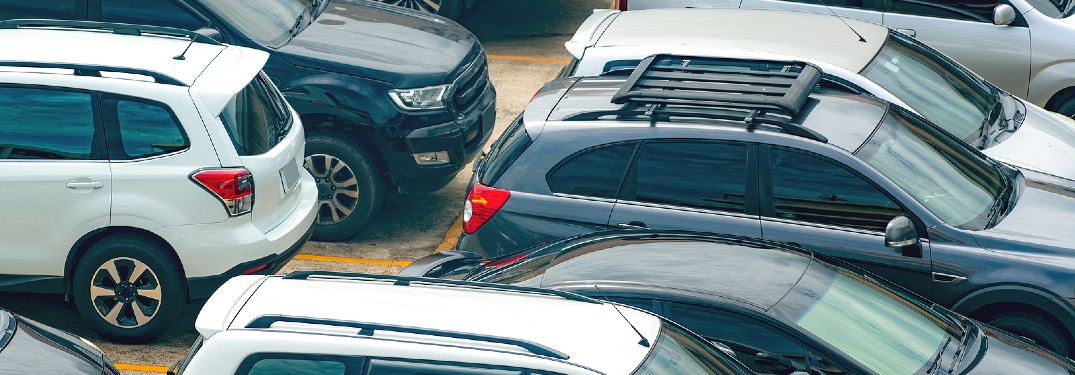 used suvs and cars angled overhead view in parking lot