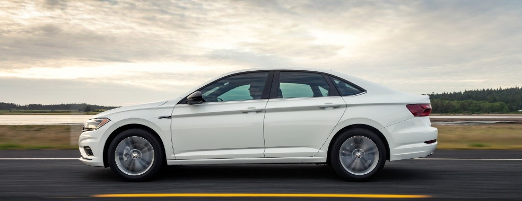 2021 Volkswagen Jetta white driving to the left
