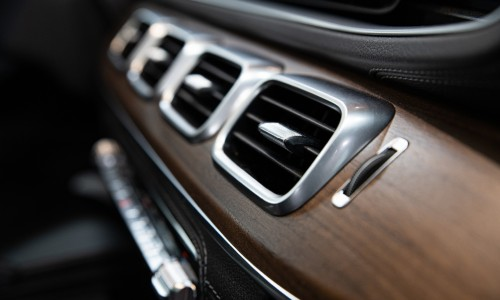 set of car air vents with wood backing close up