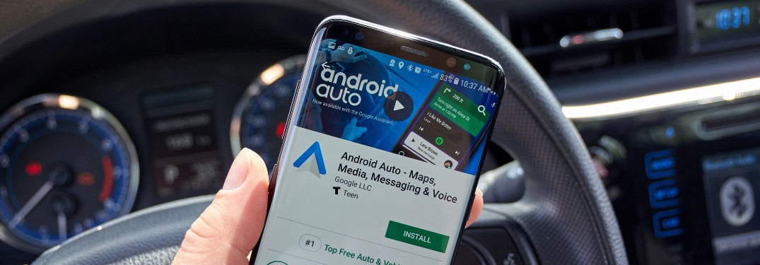 Close up of phone with Android Auto active in car