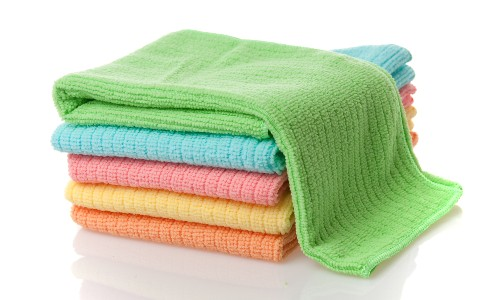 stack of colorful microfiber cloths in white background