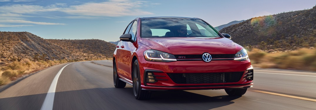 2021 Volkswagen Golf GTI red driving around long curved road