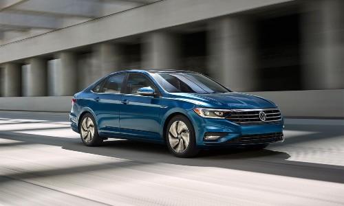 2021 Volkswagen Jetta blue driving through concrete tunnel 2019 model shown