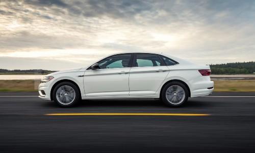 2021 Volkswagen Jetta white profile view driving left on asphalt