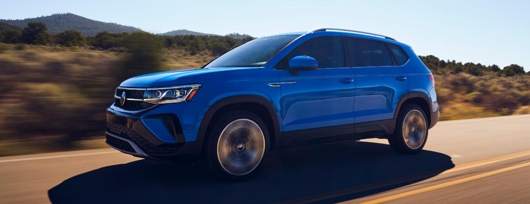 2022 Volkswagen Taos blue side view on highway