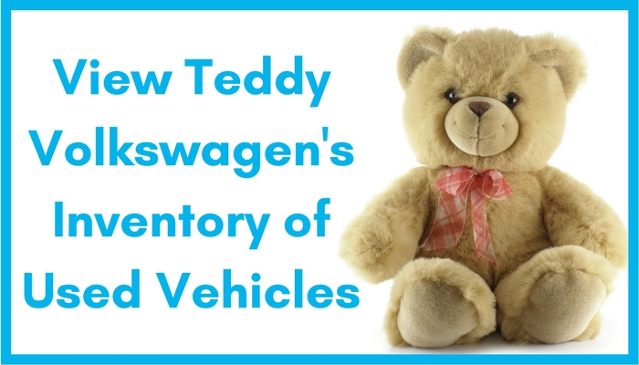 Stuffed teddy bear inviting readers to view Teddy Volkswagen's inventory of used vehicles