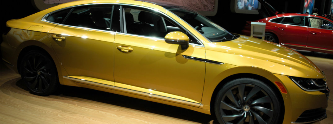 Side profile of gold-colored 2019 VW Arteon at CAS