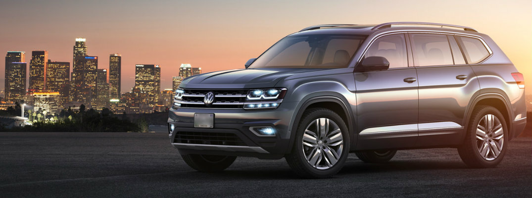 Gray 2018 Volkswagen Atlas at sunrise/sunset with city background