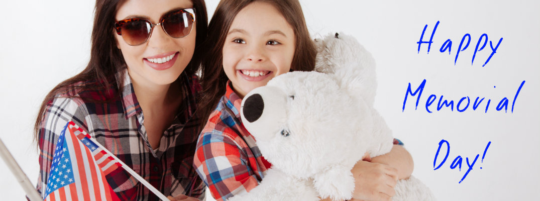 Mom and daughter with American flag and teddy bear