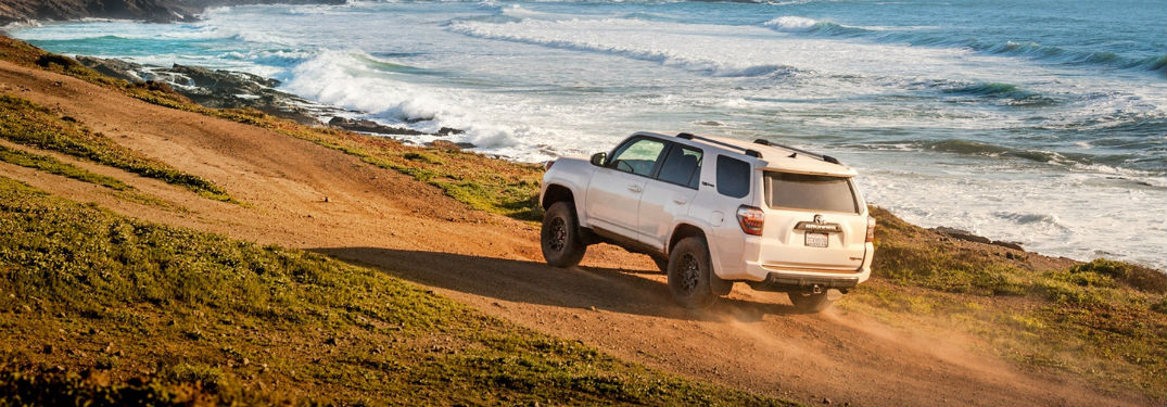 Rear driver side exterior view of a white 2018 Toyota 4Runner