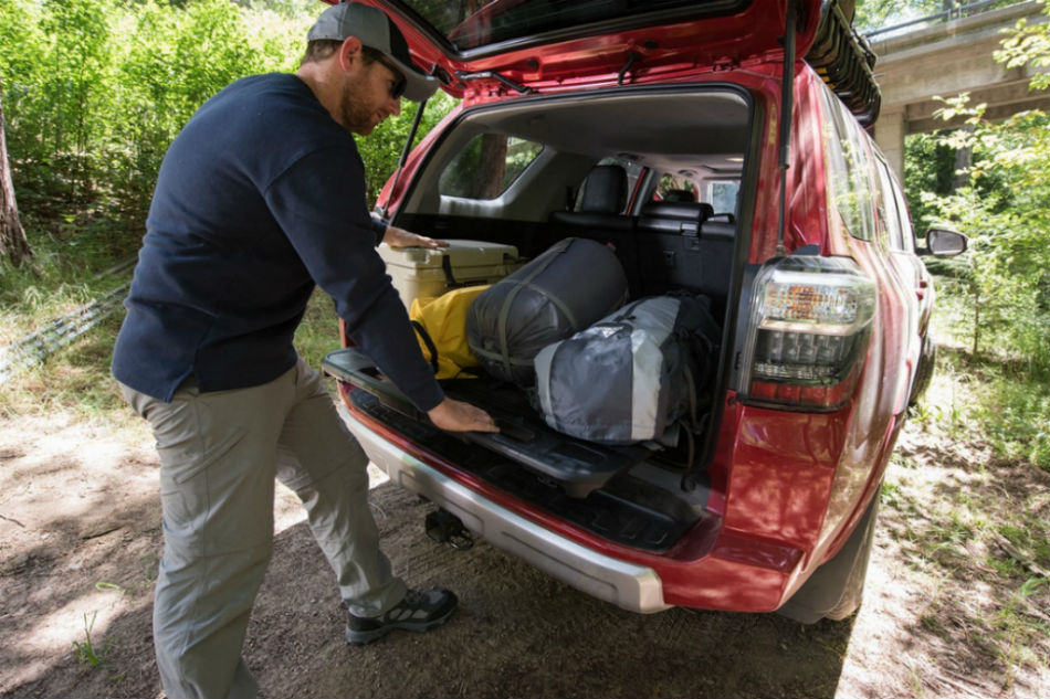Man loading the rear cargo area of the 2018 Toyota 4Runner
