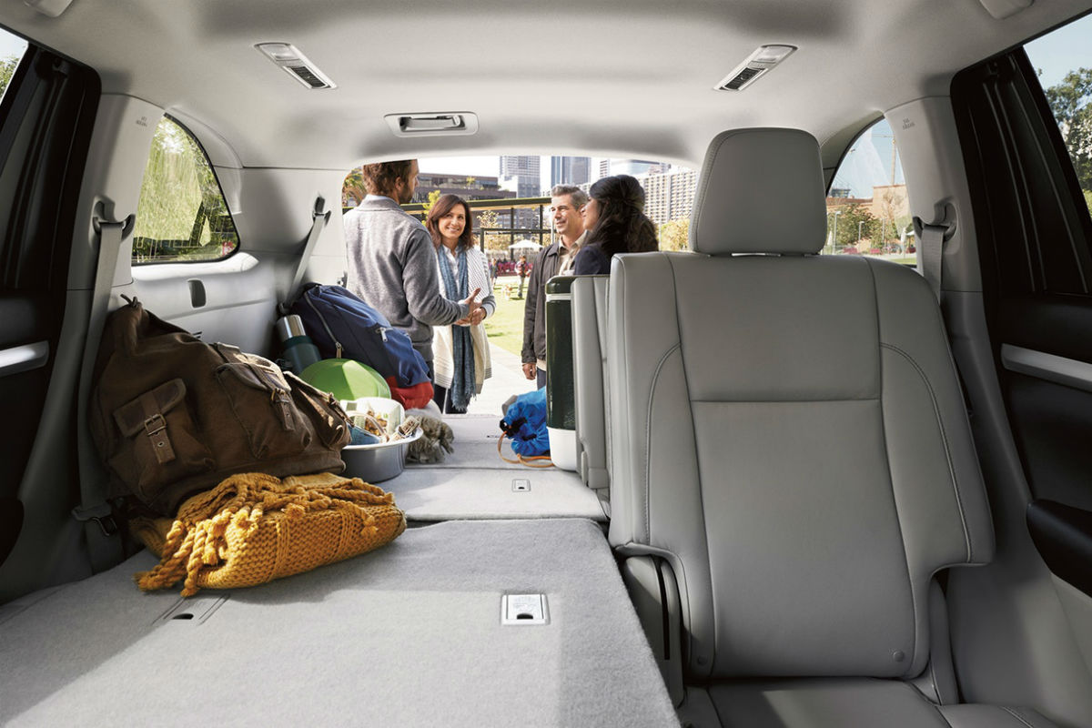 Looking into the rear cargo space of the 2018 Toyota Highlander from the front passenger seat