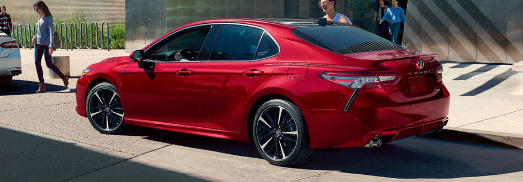 Driver side exterior view of a red 2019 Toyota Camry