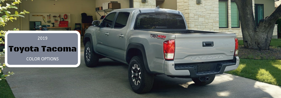 2019 Toyota Tacoma Color Options, text next to a rear driver side exterior image of a gray 2019 Toyota Tacoma