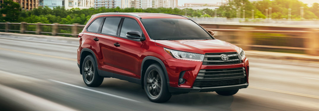 Front passenger side exterior view of a red 2019 Toyota Highlander