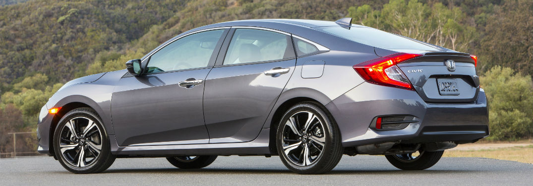 Driver side exterior view of a gray 2018 Honda Civic Sedan