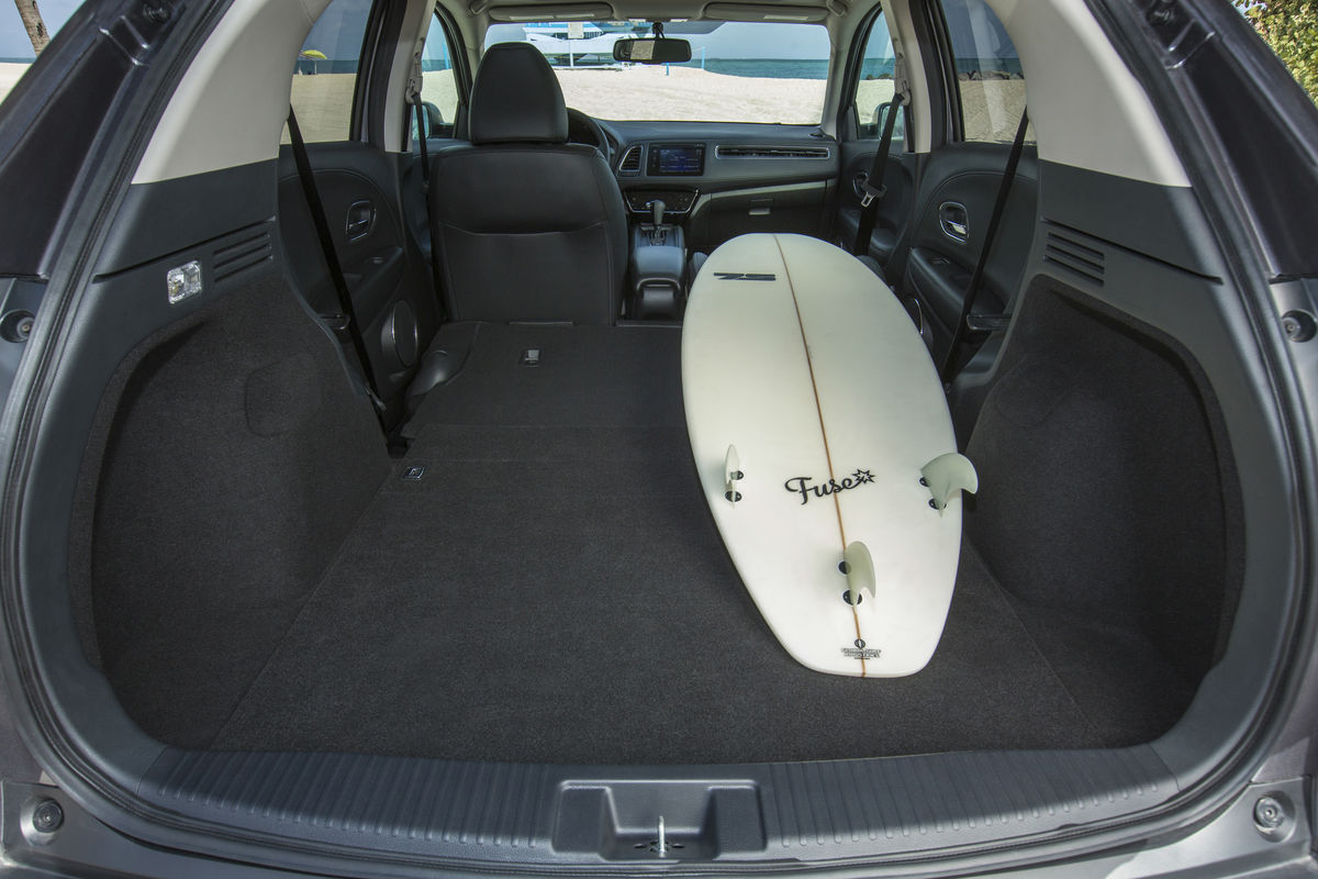 View of the second-row seat split-folded flat to accommodate a long surf board